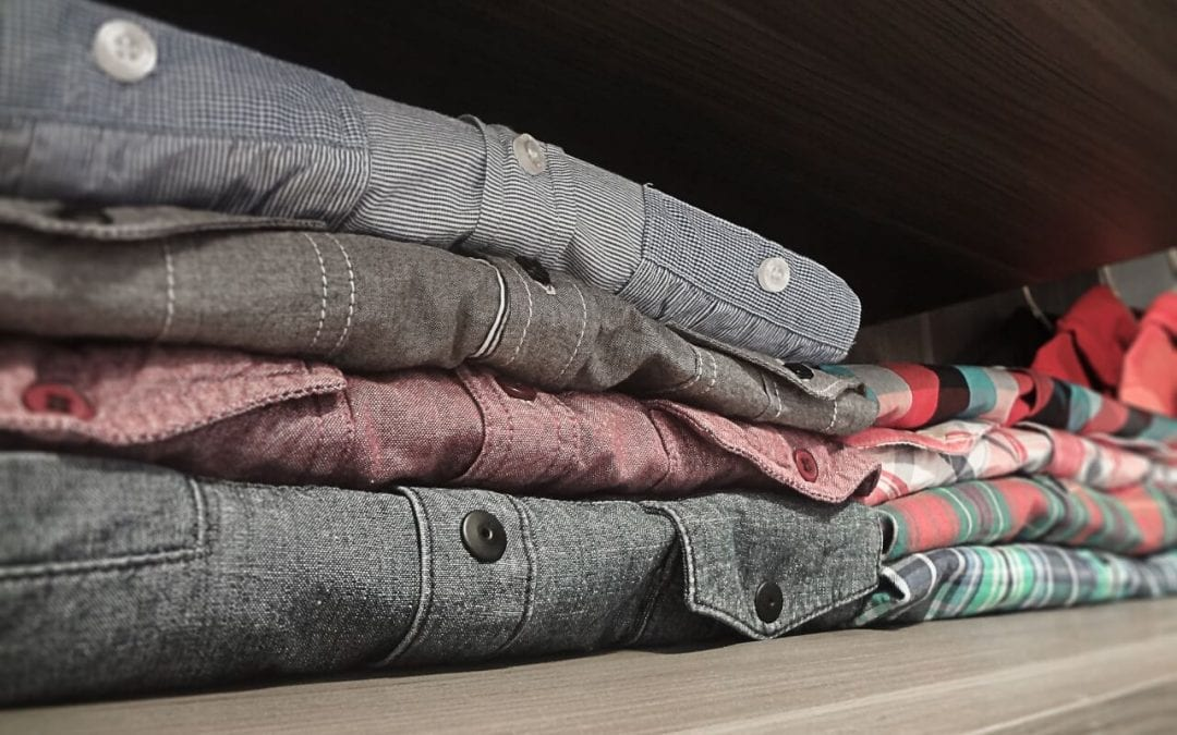 fold items to save space with your closet organization